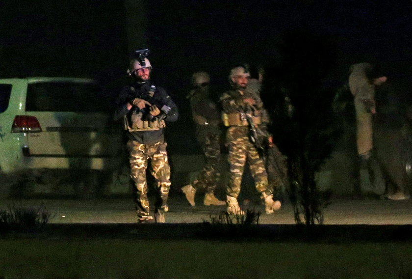 Afghan security force keep watch near the site of an attack on the Intercontinental Hotel in Kabul