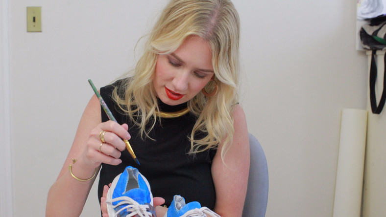Fashion illustrator Meagan Morrison painting the California shoe.