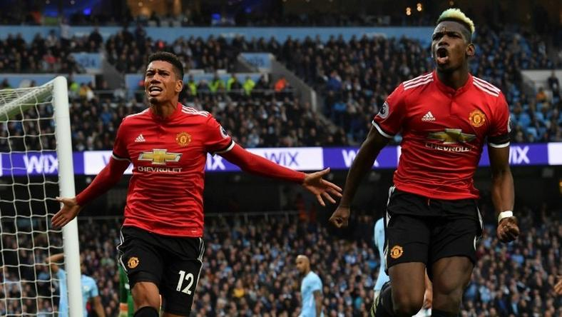 Manchester United's Chris Smalling and Paul Pogba celebrate a famous 3-2 win in April that delayed Manchester City's title celebrations