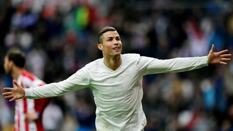 Real Madrid's forward Cristiano Ronaldo celebrates his second goal during the Spanish league football match against Real Sporting de Gijon November 26, 2016