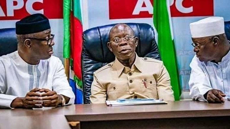 APC national chairman, Adams Oshiomhole, flanked by party men.
