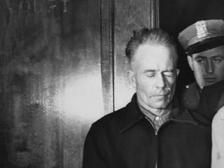 Ed Gein Being Led in Handcuffs