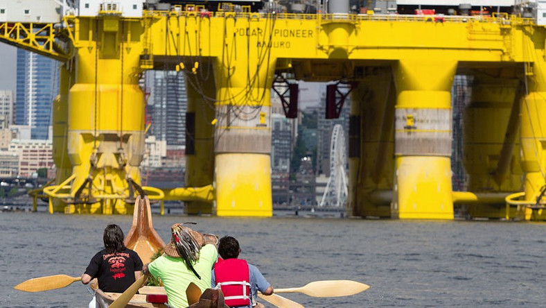 Environmental activists from the Duwamish Tribe protest the arrival of the Polar Pioneer, an oil drilling rig owned by Shell Oil, as it arrives on May 14, 2015 in Seattle, Washington.