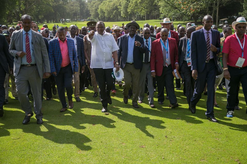 President Uhuru Kenyatta with NASA leader Raila Odinga at the Barclays Kenya Open. The two agreed to use sports to unite the country