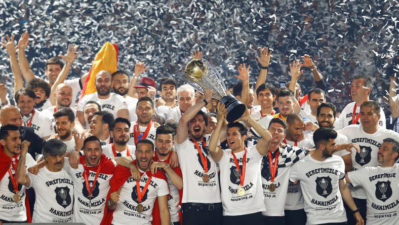 Besiktas soccer players celebrate with the Turkish Super League trophy during a championship ceremony at Vodafone Arena in Istanbul