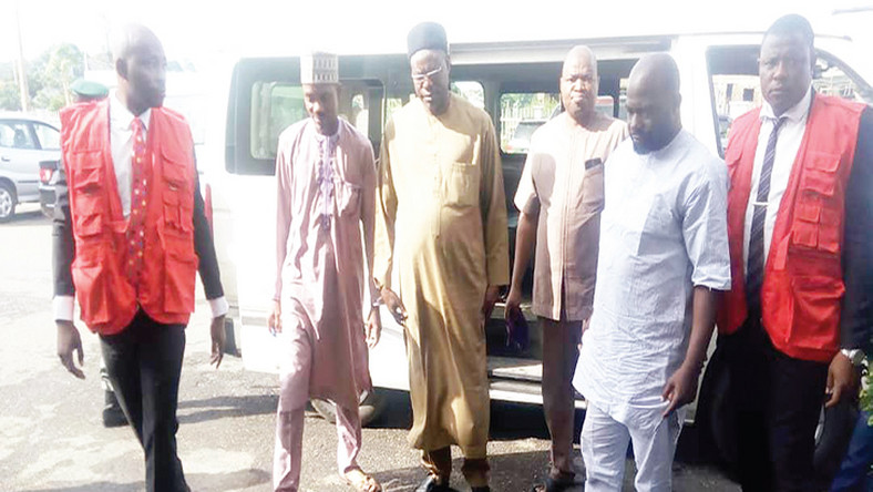 Abubakar Ishiak, Permanent Secretary, Kwara Government House and the three other accused officials being led to court by officers of the Economic and Financial Crimes Commission (EFCC) [Independent]