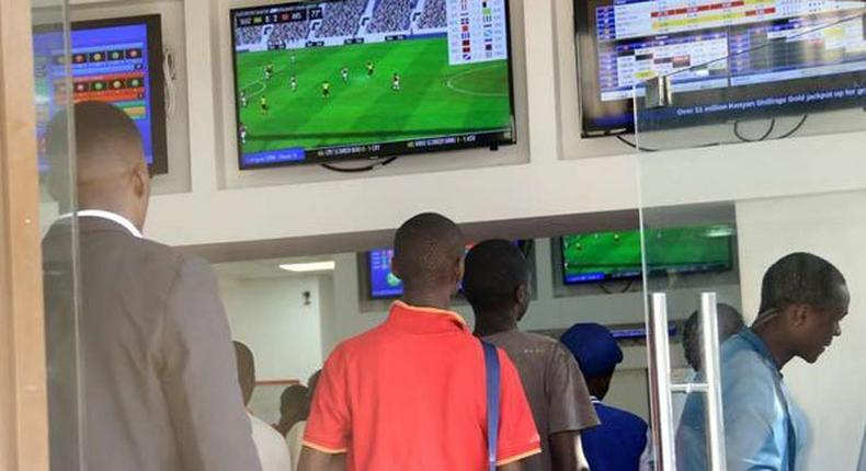 Kenyans place their bets at one of the many betting spots in Nairobi on July 30, 2016, along Market Street.