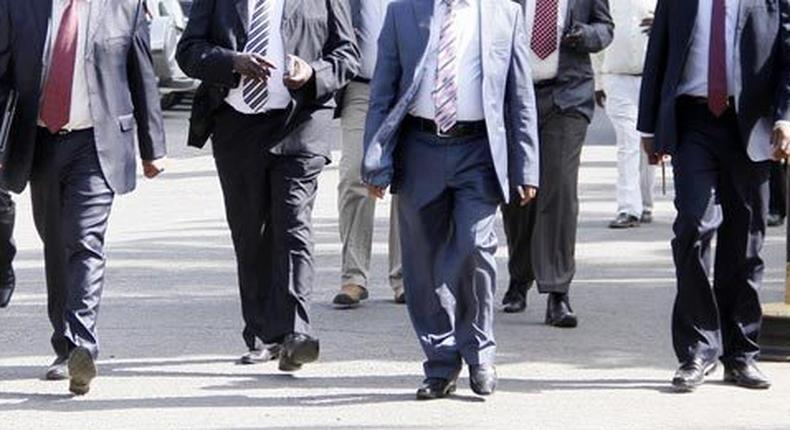 A governor with his security detail