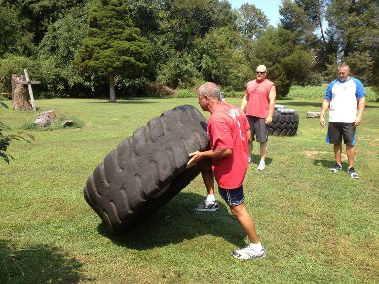 The author flipping tires with the Boss Strength and Conditioning crew.