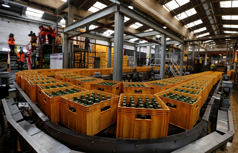Crates of Tusker Malt beer are seen on a conveyor belt at the East African Breweries Limited factory in Ruaraka factory in Nairobi.