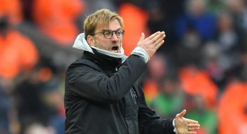 Liverpool manager Jurgen Klopp gestures on the touchline during the English Premier League match against Swansea City at Anfield in Liverpool, north west England on January 21, 2017