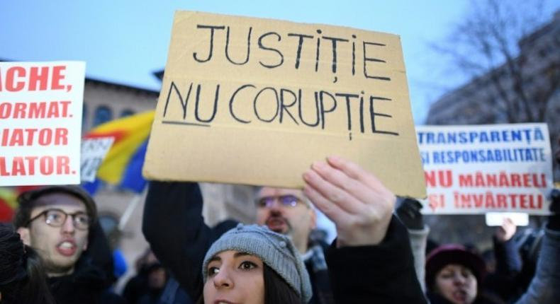 A woman holds a placard reading Justice not Corruption during a protest against government corruption in Bucharest January 22, 2017