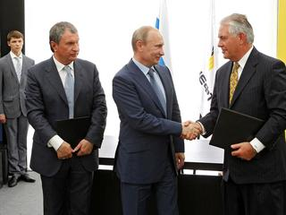 Russia's President Putin, Rosneft CEO Sechin and Exxon Mobil CEO Tillerson take part in signing cere