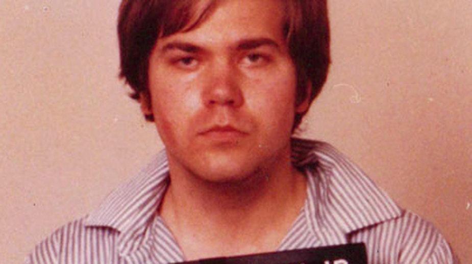 Zdjęcie policyjne Johna Warnocka Hinckley'a Jra - domena publiczna