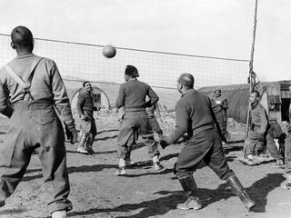 Soldiers of the Brigade of Gurkas playing volleyball
