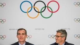 Los Angeles mayor Eric Garcetti (left) and LA 2028 chaiman Casey Wasserman (R) speak to the press in Lausanne, Switzerland, in July 2017