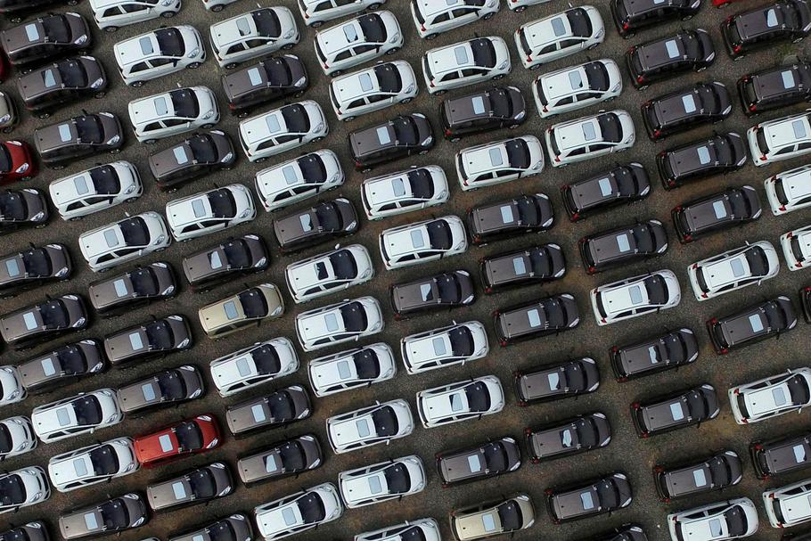 FILE PHOTO: Electric cars are seen at a parking lot of an automobile factory in Xingtai, Hebei provi
