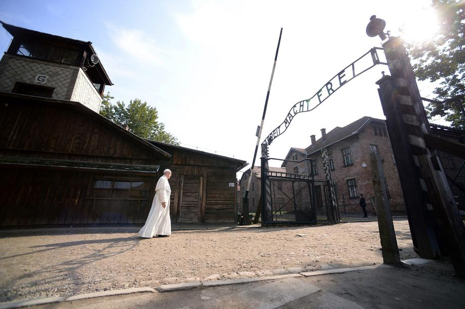 Pope Francis walks through Auschwitz's notorious gate during his visit to the former Nazi death camp
