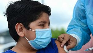 A boy receives the first dose of the Pfizer/BioNTech COVID-19 vaccine in Tegucigalpa, on September 25, 2021, during a vaccination programme for teens aged 12 to 15
