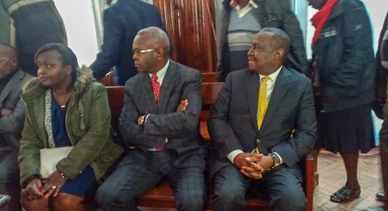 CS Henry Rotich, PS Kamau Thugge and PS Susan Koech at the Milimani law court