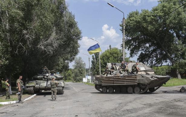 Ukraińcy twierdzą, że po stronie prorosyjskich separatystów walczą już rosyjscy oficerowie EPA/ANASTASIA VLASOVA