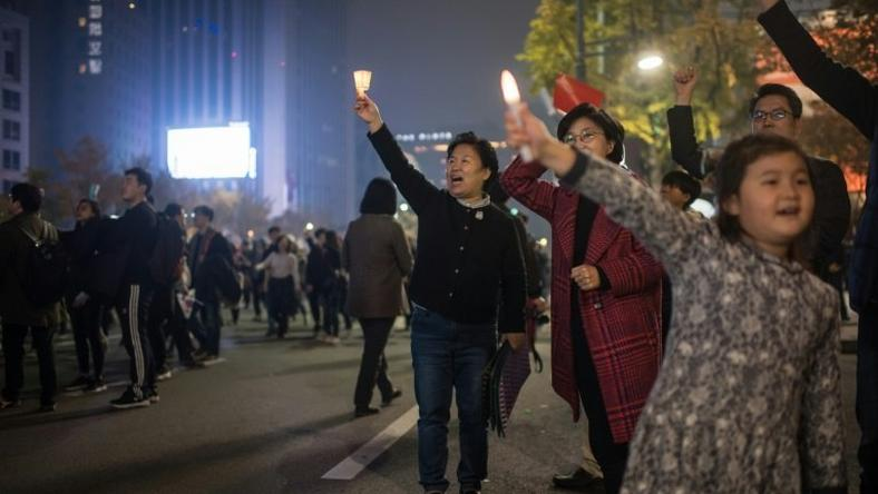 Demonstrators gather during a protest calling for the resignation of South Korean President Park Geun-Hye, at Gwanghwamun square in Seoul, on November 5, 2016