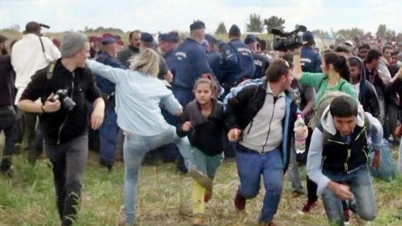 This video grab made on September 9, 2015 shows a Hungarian TV camerawoman later named as Petra Laszlo kicking a child as she run with other migrants from a police line during disturbances at Roszke, southern Hungary