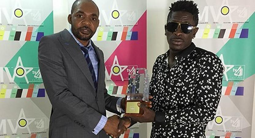 Shatta Wale receiving his 4syte Music Video award during the presentation.
