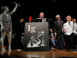 Horiuchi of Japan accepts the Ig Nobel for Medical Education during the Ig Nobel awards ceremony at