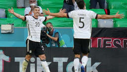 Robin Gosens (L) celebrates scoring Germany's fourth goal in Munich on Saturday at Euro 2020 Creator: Matthias Schrader