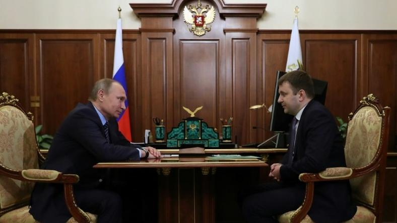 Russian President Vladimir Putin meets with deputy finance minister Maxim Oreshkin at the Kremlin in Moscow on November 30, 2016