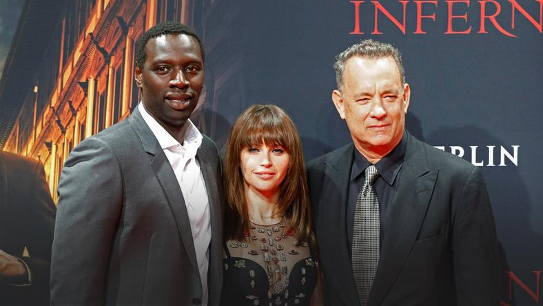 "Actors Omar Sy, Felicity Jones and Tom Hanks pose at a screening of ""Inferno"" in Berlin"