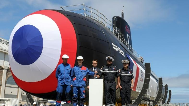 The first of France's new nuclear-powered attack submarines was launched in dry dock by President Emmanuel Macron