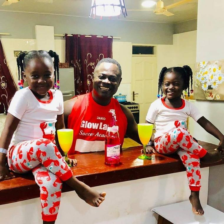 Odartey Lamptey with his two daughters