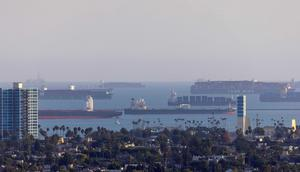 Container ships wait off the coast of the congested ports of Los Angeles and Long Beach, in Long Beach, California, U.S., September 29, 2021.