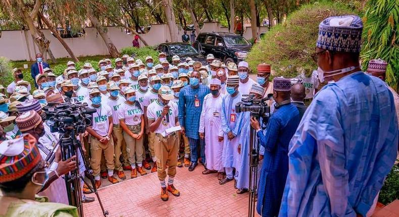 President Muhammadu Buhari with NYSC corps members [Presidency]