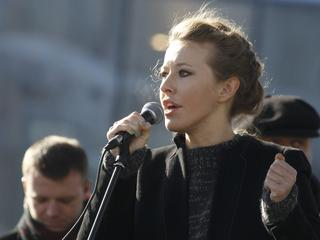 Television host and opposition activist Sobchak delivers a speech during a demonstration for fair el