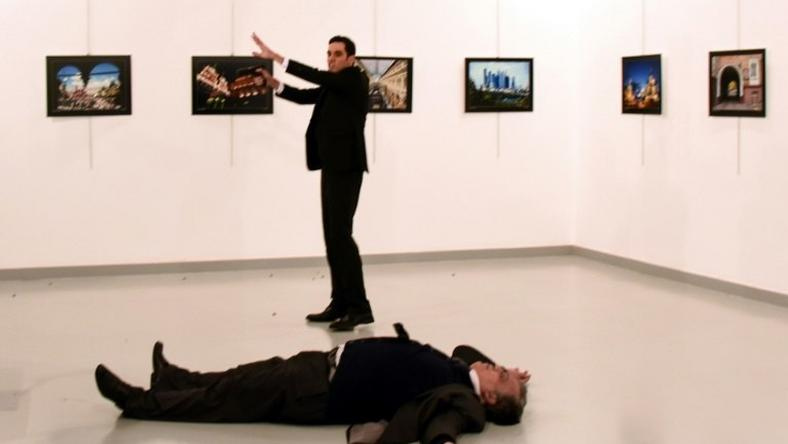 Andrei Karlov (front), the Russian ambassador to Ankara, lies on the floor next to his killer during an art exhibition in Ankara, on December 19, 2016