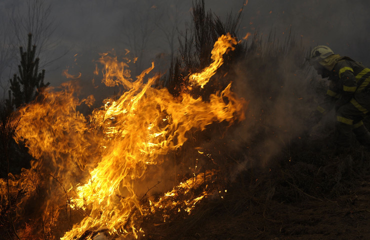 229690_spnija-fire-afp