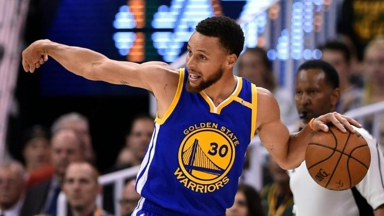 Stephen Curry of the Golden State Warriors directs play in the first half against the Utah Jazz in Game Four of the Western Conference semi-finals during the 2017 NBA Playoffs, at Vivint Smart Home Arena in Salt Lake City, on May 8
