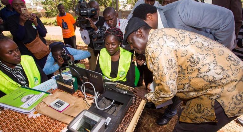 Raila Odinga (right) during an inspection of the Mass Voter Registration (MVR) exercise at Lavington Primary School.