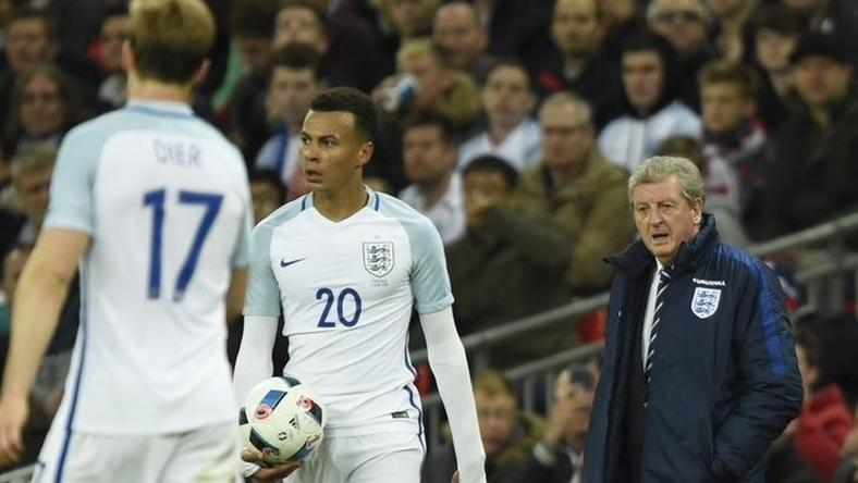 England manager Roy Hodgson look on at Dele Alli and Eric Dier