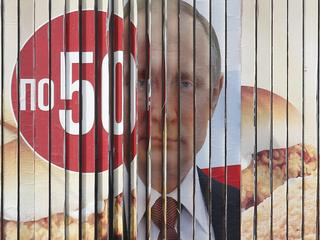 A board, advertising the campaign of Russian President Putin ahead of the presidential election, is