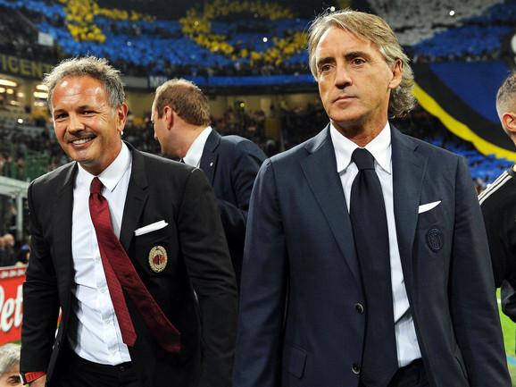 Mihajlović dok je vodio Milan, sa svojim dobrim prijateljem Robertom Mančinijem koji je tada vodio Inter