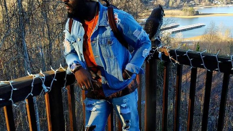 Jim Iyke in ripped denim