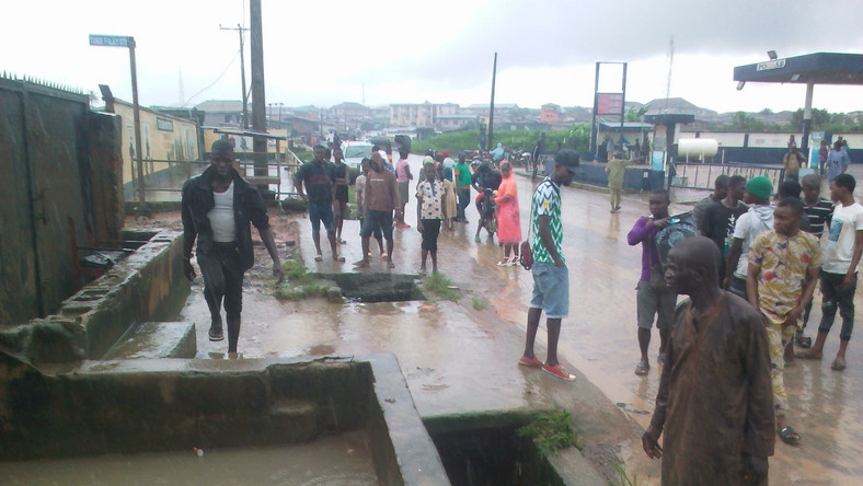 The drain beside the Aboru -Iyana-Ipaja canal along Ige Road that carried away the victims on Saturday (NAN)