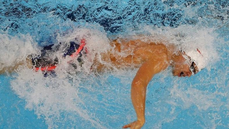 Michael Andrew of the US swims the 3rd leg of the 4x50m freestyle preliminary, during the 13th FINA Short Course World Swimming Championships, in Windsor, Ontario, Canada, on December 9, 2016