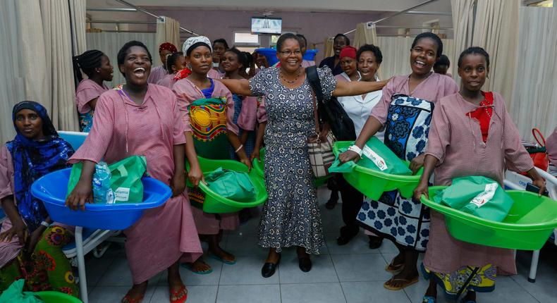 New mothers at Coast General Hospital in jovial mood showcase baby packspresented by Safaricom Foundation. This was during a visit by SafaricomFoundation members and health stakeholder's after a day workshop onsustaining maternal, newborn, child and adolescent health in Mombasa.