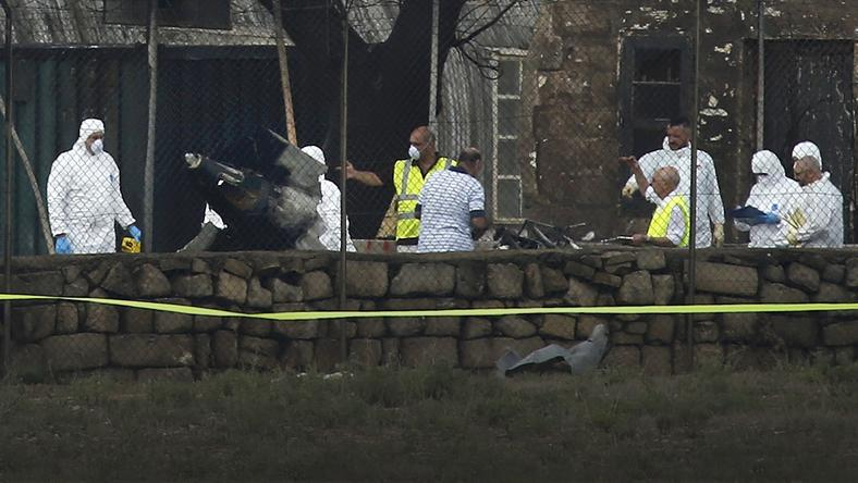 Investigators and rescue services at scene of plane crash at Valetta airport in Malta
