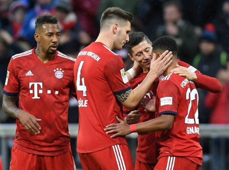 Robert Lewandowski bagged a pair of goals as Bayern eased past Nuremberg